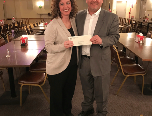 Board member Keith Horner, presents a Foundation grant check to Beth Steiner, Director of the Auglaize County Public Library.